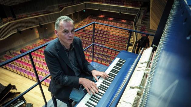 Piano constructor and builder David Klavins plays his new creation.(AFP File Photo)