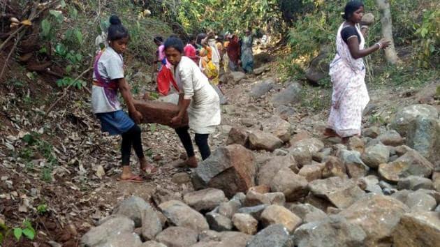 Villagers storing stones to make a boundary for rain water harvesting at Ara-Keram Village under Ormanjhi block in Ranchi on July 28, 2019.(Hindustan Times)
