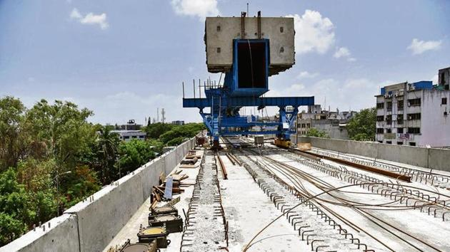 Work on elevated tracks for Metro route in Pimpri-Chinchwad well underway.(HT)