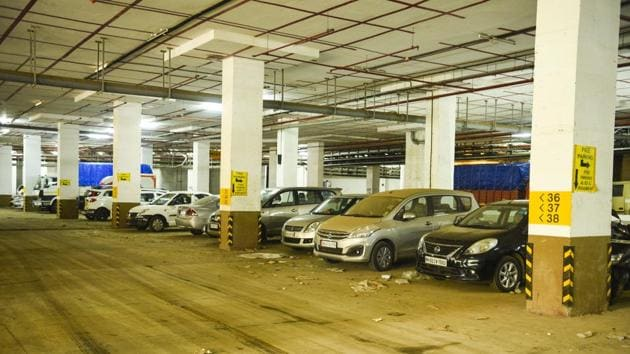 A local shop owner said that the number of illegally parked cars in the area have visibly reduced since the revised fares were introduced.(Pramod Thakur/HT Photo)