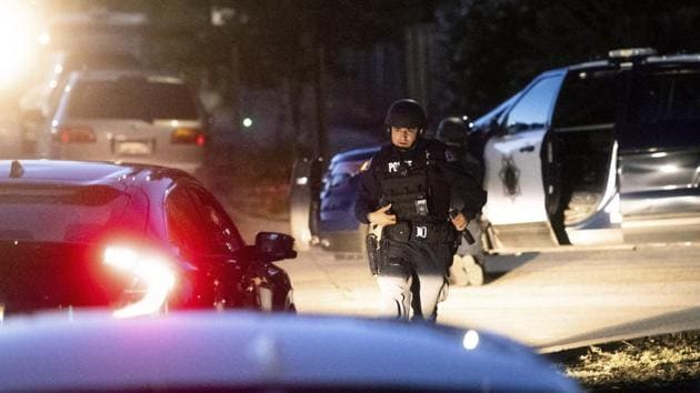 Police work a scene after a deadly shooting at the Gilroy Garlic Festival in Gilroy, Calif., Sunday, July 28, 2019.(AP photo)