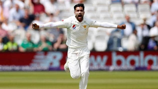 Pakistan's Mohammad Amir celebrates taking the wicket of England's Mark Wood.(REUTERS)