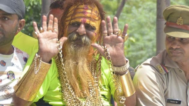 Sudhir Makka, also known as Golden Baba for his penchant for gold jewellery, had donned 14 kg gold this year during the Kanwar yatra.(Sakib Ali / HT Photo)