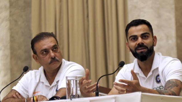 Indian cricket team coach Ravi Shastri, left, looks on as captain Virat Kohli addresses a press conference.(AP)
