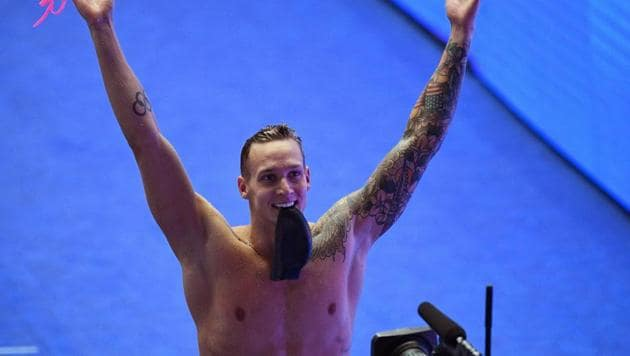 Caeleb Dressel celebrates taking gold in the final of the men's 100m butterfly event during the swimming competition at the 2019 World Championships in Gwangju, South Korea.(AFP)