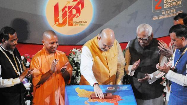 Uttar Pradesh Chief Minister Yogi Aditiyanath, Home Minister Amit Shah who was the chief guest, and others at the second ground breaking ceremony of 'UP Powering New India' where Governor Ram Naik was also present at Indira Gandhi Pratishthan, Gomti Nagar, Lucknow on Sunday, July 28, 2019.(Dheeraj Dhawan/Hindustan Times)