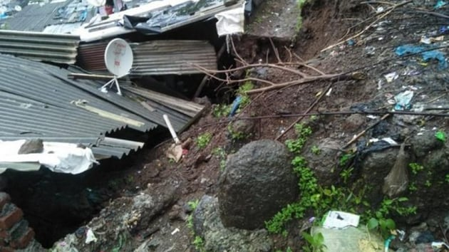 The deceased Birendra Jaswal, 40 and his son Sunny Jaswar, 10 were caught beneath the debris after the wall of their house collapsed due to the landslide.(HT Photo)