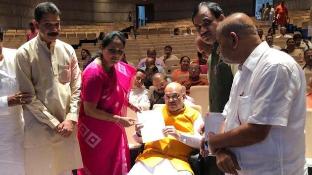 BJP MP Shobha Karandlaje meets Union Home Minister Amit Shah, submits a letter to him, seeking help of central government to trace missing founder & owner of Cafe Coffee Day, VG Siddhartha, in New Delhi on Tuesday.(ANI photo)
