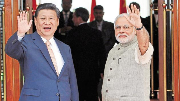 acknowledged the need for peace along their disputed border during a meeting of the Working Mechanism for Consultation and Coordination (WMCC) on India-China Border Affairs held in Beijing. In this picture, Prime Minister Narendra Modi (R) and China's President Xi Jinping wave before their meeting in the western Indian city of Ahmedabad September 2014.(REUTERS)