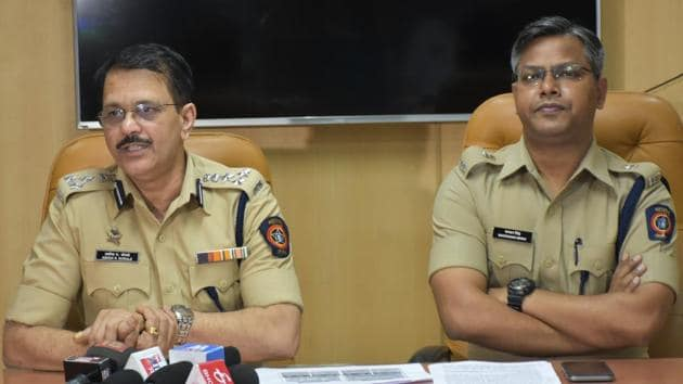 (Left) Ashok Morale, additional commissioner of police (crime) with deputy commissioner of police (crime) Bachchan Singh at a press conference held on Tuesday.(HT PHOTO)