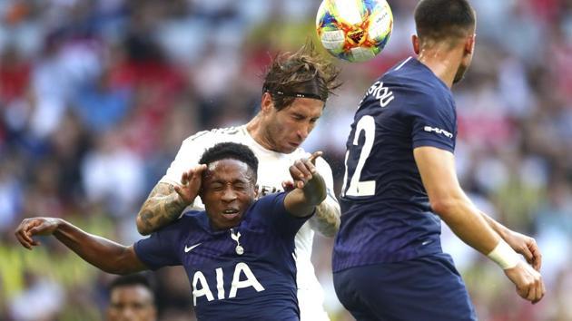 Real's Sergio Ramos, center, and Tottenham's Kyle Walter-Peters(AP)