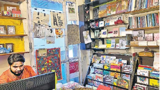 The book shop at the back of Regal cinema building is so small that three browsers make it feel jam-packed.(HT Photo)