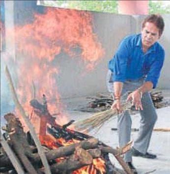 Neeraj Tamboliya cremates an unclaimed body in Jaipur.