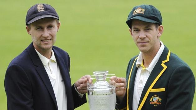 Australia's captain Tim Paine, right, and England captain Joe Root pose with the Waterford Crystal trophy before the first Ashes Test.(AP)