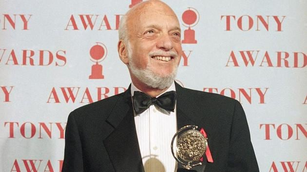"""FILE - In this June 4, 1995 file photo, Harold Prince holds his Tony award for best director in a musical for """"Show Boat,"""" at Broadway's Minskoff Theater in New York. (AP Photo/Richard Drew, File)(AP)"""