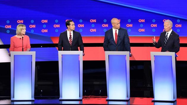 Moderate frontrunner Joe Biden and his 2020 Democratic rivals took the stage Wednesday ready for a dog fight but began their debate largely with cooler heads prevailing, uniting under a common goal of ousting President Donald Trump.(AFP Photo)