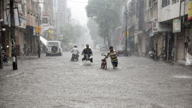 A view of the Siddharatha Bungalows on Sama-Savali Road, Vadodara. The city has been lashed by heavy rainfall leading to water-logging in many areas.(PTI Photo)