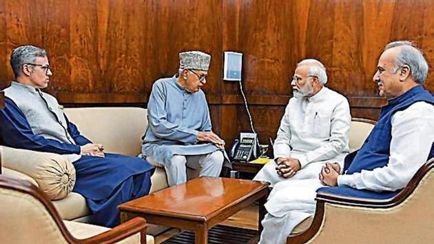 Former J&K CMs Farooq Abdullah, Omar Abdullah and MP Hasnain Masoodi with PM Modi in New Delhi on Thursday.(ANI Photo)