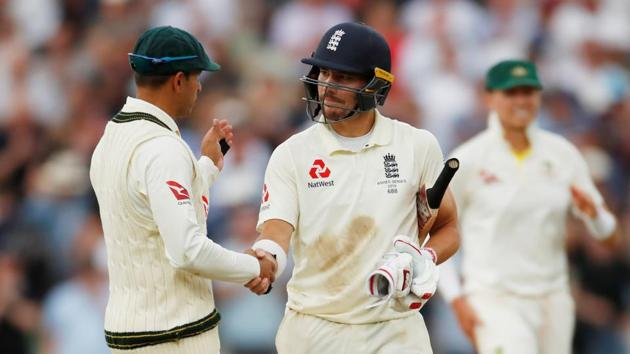 England's Rory Burns with Australia's Usman Khawaja at the end of play.(Reuters)