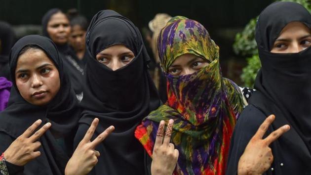 Muslim women celebrate the passage of Triple Talaq Bill in the Rajya Sabha.(PTI)