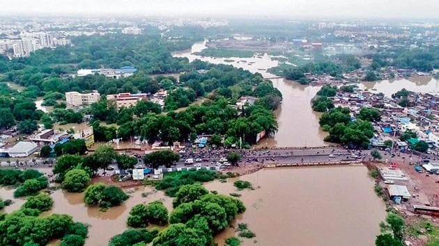 An aerial view of the flooded streets after heavy rainfall in Vadodara on Friday.(Photo: ANI)