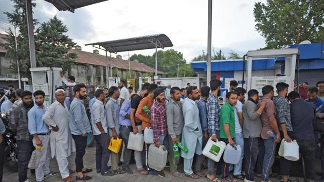 """Srinagar, India-August 02, 2019: People stand in a queue at a petrol pump after an advisory was issued by the state's home department for the Amarnath pilgrims and tourists in Kashmir, in Srinagar, Friday, August 2, 2019. The Jammu and Kashmir government on Friday asked Amarnath Yatris and tourists in Kashmir to """"immediately"""" curtail their stay and leave the valley. The advisory, issued by the state's home department, cited intelligence inputs about terror threats. (Photo by Waseem Andrabi/ Hindustan Times)"""