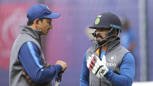 India's Kedar Jadhav speaks to batting coach Sanjay Bangar in the nets at the Cricket World Cup match.(AP)