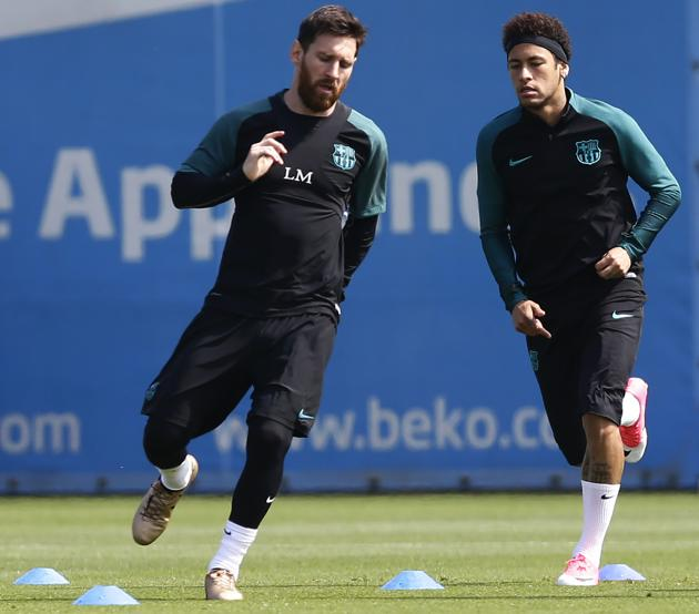 Neymar training with Lionel Messi when he was at Barcelona.(AP)