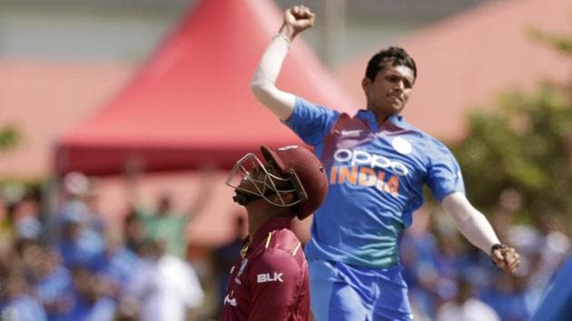 West Indies' Shimron Hetmyer, left, reacts as he is bowled by India's Navdeep Saini.(AP)