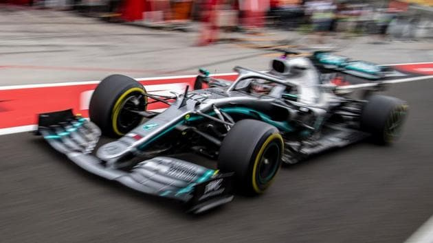 Mercedes' British driver Lewis Hamilton steers his car during the first practice session(AFP)