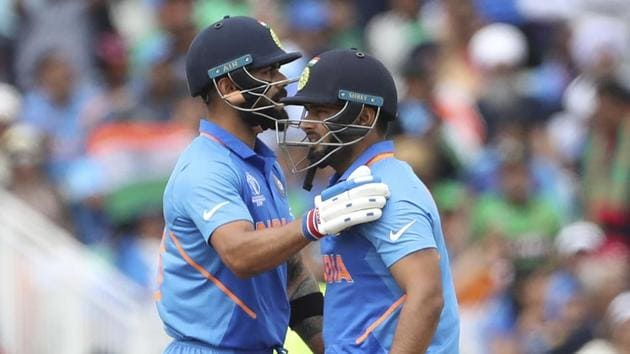 India's captain Virat Kohli, left, pats teammate Rishabh Pant(AP)