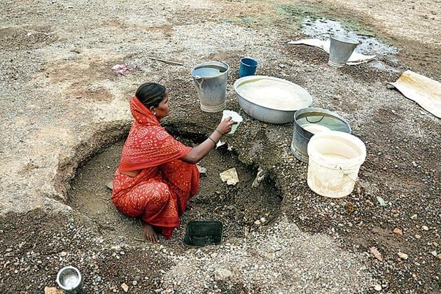 As water is supplied only once in 15 days here, only option left for villagers to fulfil their daily needs is a dried riverbed.(Sanjay Sadavarte/ HT photo)