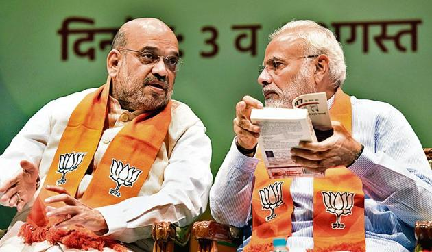 Prime Minister Narendra Modi in conversation with Union Home Minister Amit Shah during the Abhyas Varga (Sansad Karyashala) for all BJP Members of Parliament at Parliament Library Building in New Delhi on Saturday, August 03, 2019.((Photo by Sonu Mehta/ Hindustan Times))