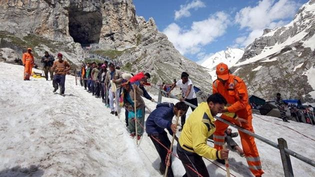 Pilgrims leave the holy cave of Lord Shiva after worshipping in Amarnath, southeast of Srinagar.(Reuters File Photo)
