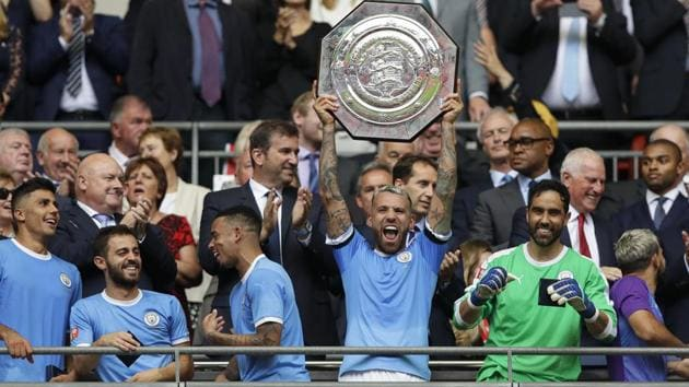Manchester City's Nicolas Otamendi lifts the trophy after the English Community Shield match against Liverpool.(AP)