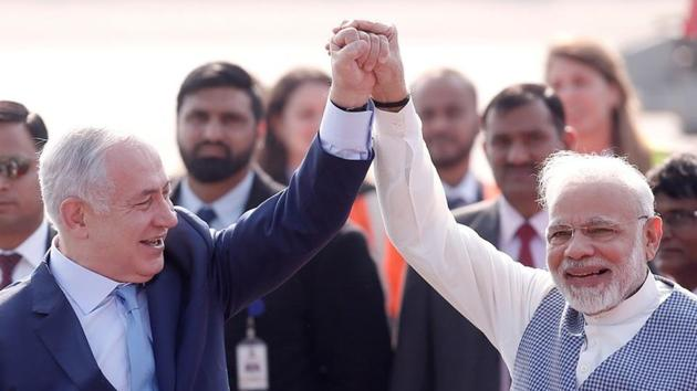 Israel embassy attached a video clip that shows several photographs of Prime Minister Narendra Modi and his Israeli counterpart Benjamin Netanyahu shaking hands.(Arvind Yadav/HT File PHOTO)