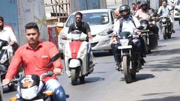 9 youths were fined for riding bikes with fancy number plates in Rajgurunagar on August 3.(HT FILE)