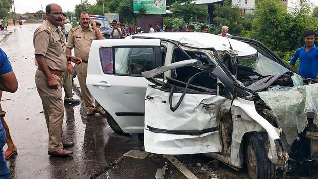 Police near the wreckage of the car in which the Unnao rape survivor was travelling during its collision with a truck near Raebareli on July 28, 2019.(PTI Photo)