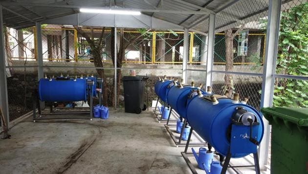 The bio-composter machines installed at Green Garden Apartments in Shivneri Nagar, Govandi (East) are used to convert 50kg of organic waste into nutrient-rich manure.(HT Photo)