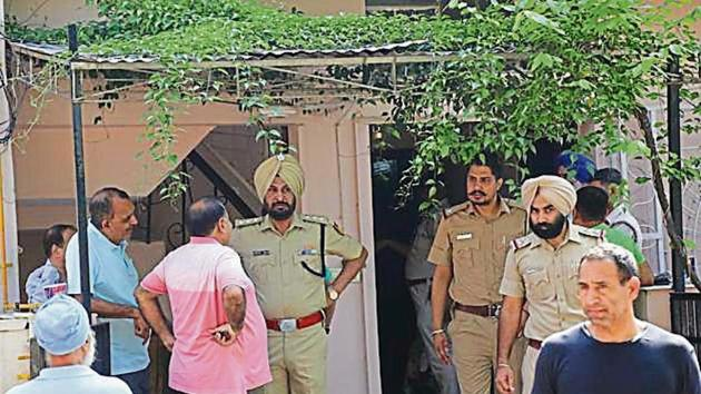 Police officials investigating the suicide and murder at the couple's Sector 40 house in Chandigarh on Sunday.