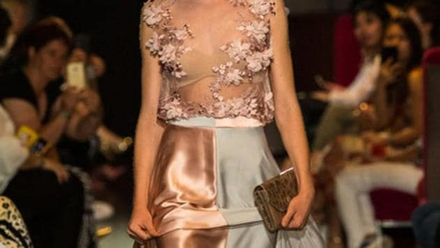 A model walks the ramp with Mayu's fish skin leather bags