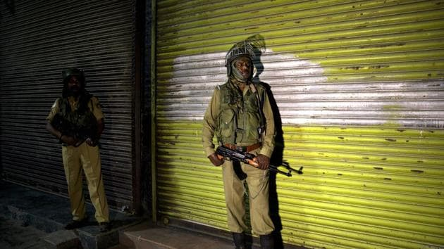 Indian soldiers stand guard in the night in Srinagar, India, Sunday, Aug. 4, 2019. Authorities have decided to impose restrictions across the Kashmir Valley from early Monday morning.(Photo: AP)