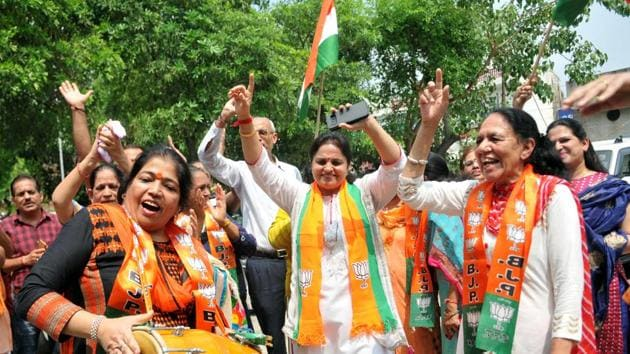 BJP supporters celebrate after Union Home Minister Amit Shah introduced the proposal to remove Article 370 in the state, in Jammu, Jammu and Kashmir, India on Monday, August 5, 2019. (Photo by Nitin Kanotra / Hindustan Times)