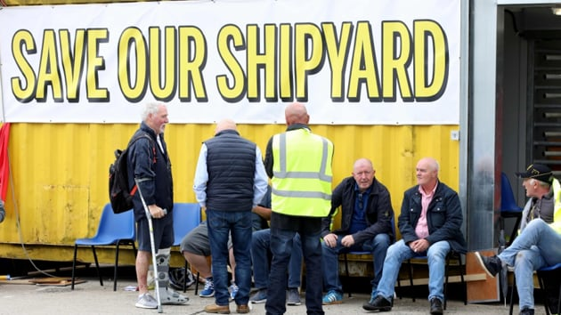 "They emerged from a meeting chanting ""save our shipyard"" before confirming the outcome of the vote.(AFP image)"