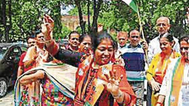 Members of political parties were seen dancing, bursting crackers and distributing sweets on Jammu streets, hailing the decision by the BJP-led NDA government.(Photo: AP)