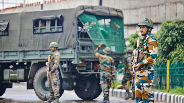 Army personnel stand guard during restrictions, in Jammu.(PTI Photo)
