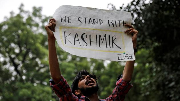 A man holds a sign and shouts slogans during a protest after the government scrapped the special status for Kashmir, in New Delhi, India, August 5, 2019.(REUTERS)