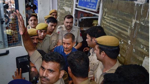 Expelled BJP MLA and accused in the Unnao rape case Kuldeep Singh Sengar is being taken to Tihar jailafter being produced at Tis Hazari court, in New Delhi on Monday.(Photo: PTI)