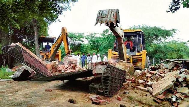 Delhi government's revenue department undertook a demolition drive at Jounapur village in south Delhi on Tuesday, Aug 6, 2019.(HT Photo)