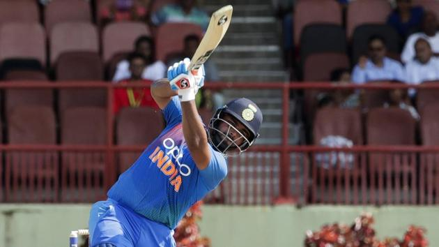 India's Rishabh Pant hits out to score the winning run as West Indies wicketkeeper Nicholas Pooran looks on during their third T20 international cricket match in Providence, Guyana, Tuesday, Aug. 6, 2019. India won by seven wickets.(AP)